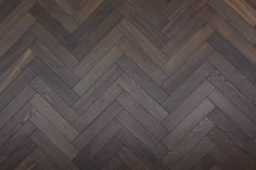 Herringbone Parquet Engineered Wood Floor Brownie deep smoked engineered herringbone parquet flooring developed by Unique Bespoke Wood, suitable for commercial and residential projects. Parquet Texture, Wood Floor Texture, Wood Parquet, Tiles Texture, Wooden Flooring, Hardwood, Unique Flooring, Wood Floor Pattern, Herringbone Wood Floor