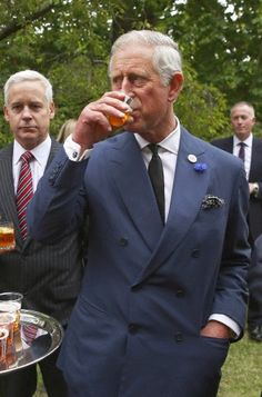 Prince Charles, Prince of Wales samples beer during a reception to celebrate the 21st anniversary of Duchy originals products at Clarence House on 11 Sep 2013 in London, England.