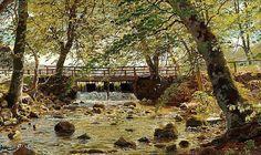 Peder Mønsted: A roaring stream under a bridge in - by Bruun Rasmussen
