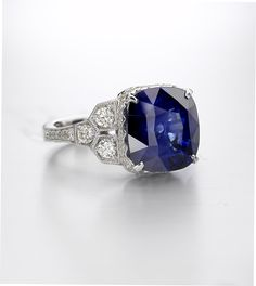 Blue sapphire and diamond vintage inspired Platinum ring by Christopher Designs NYC. For more information email info@christopherdesigns.com