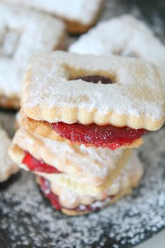 Strawberry Linzer Cookies - These soft, buttery, sugar dusted, jam packed Strawberry Linzer Cookies are perfect for weeknight desserts or on a holiday table!