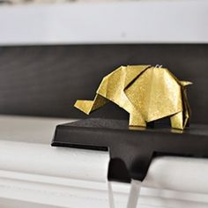 Make this cute glitter elephant for Christmas.  Video tutorial included.