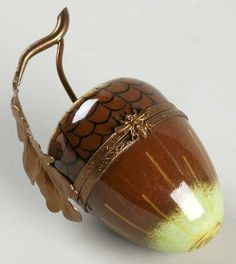 PRecious Treausre: An exquisite Acorn trinket box by  >the< Limoge porcelain company.  No age info provided.