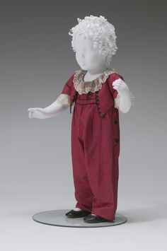 Boy's red silk skeleton suit with lace collar and cuffs, American, ca. 1790-1810.