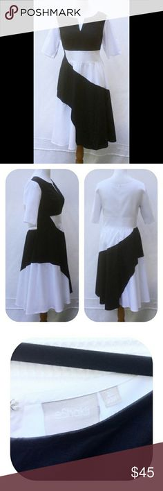 "🌼🌼NWOT eshakti Fit&Flare Dress🌼🌼 Brand new/unworn eshakti black & white fit and flare dress. Size 20W Measured flat: pit 2 pit: 44"",  Waist: 41¼"", Length: 44"" Sleeve: 13""  Scoop neck, elbow length sleeves. Back hidden zipper , hook & eye closure, wide waist. Princess seamed bodice, full skirt, side seam pockets. Lined in cotton voile. Cotton, woven poplin, pre-shrunk, smooth finish, light, mid-weight. Machine wash cold.. New w/tags removed to prevent return to eshakti *Ask questions B4 U…"