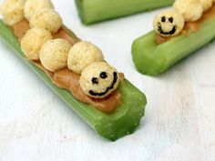Caterpillars on a Log: Adorable, smiling caterpillars crawling across peanut butter-stuffed celery sticks make a great after school snack!
