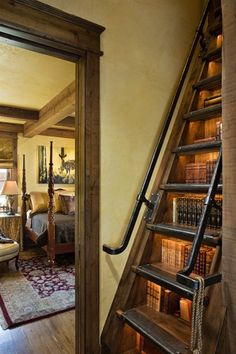 It took a good bit of searching but I finally tracked down the origin of this staircase/ladder/bookcase. It's part of the Old River Farm design and can be found most of the way down in the Locati Architects & Interiors (Bozeman, MT) picture gallery.