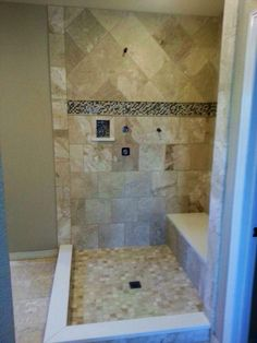 Travertine shower with a small soap box. Sweet!