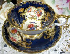AYNSLEY COBALT ARISTOCRATIC TEA CUP AND SAUCER FLORAL GOLD
