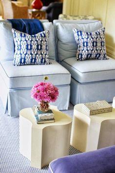 Pale blue slipper chairs.