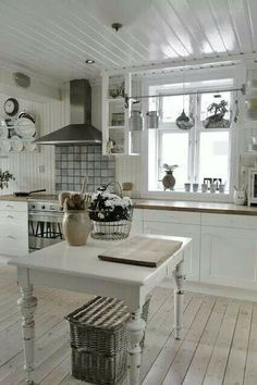 Rustic farmhouse kitchen with a stainless steel range and tiled backsplash