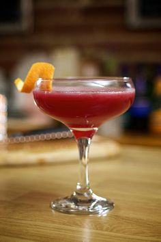 Ruby Zing named by Emma Bennett. - 50ml Gin - 25ml Creme de cassis - 25ml Lemon - 25ml Grenadine - 25ml Cranberry juice Pour ingredients into shaker with ice. Shake. Strain into coupe (or martini glass) and garnish with orange peel. Drink!