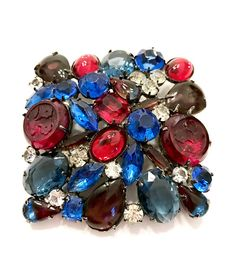 Wow a stunning large Juliana D&E multi-color brooch  Big and gorgeous is the only way to describe this beautiful pin. Composed of wonderful art glass cabochons in rich jewel tones of ruby red, sapphire blue, and ice. There are even two large and very special molded red floral stones,