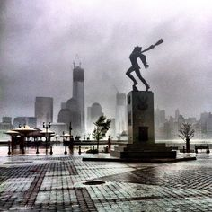A statue braves the wind – TIME