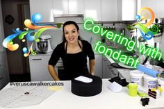 Covering cake with fondant.