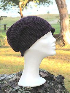 Ravelry: Wool hat in Tunisian crochet/Rundkrokad yllehat pattern by Ann Linderhjelm.  Free Pattern