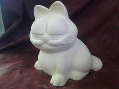 Hey, I found this really awesome Etsy listing at https://www.etsy.com/listing/179919709/garfield-cat-bank-ready-to-paint-ceramic