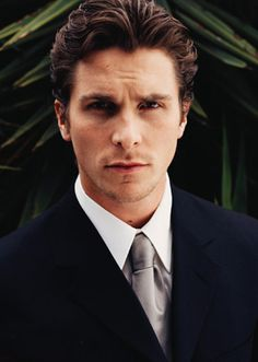 i say yesiree to christian bale with a clean shaven face and a crisp suit