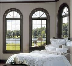 The traditional Vinyl double hung window becomes much more dramatic when combined with the special shape of the half round window.