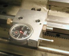 """Lathe carriage stop combining an adjustable stop and dial indicator. I can something like this on my 7"""" swing mini lathe."""