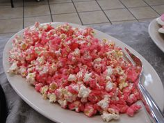 """Strawberry Popcorn.  I found this recipe at Food.com.  It's called Pink Elephant Popcorn and delicious!!  Very Easy to make!  I added extra jello for more flavor and baked it an additional 10 minutes.  It can be made the night before and stored in an airtight container.  If it gets """"soft"""" pop it back in the over at 250 for about 20 minutes!"""
