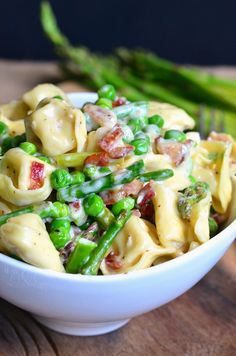 Delicious creamy tortellini dish made comforting with Parmesan cream sauce and crispy bacon and it's also loaded with peas and asparagus.