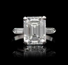 A Platinum and Diamond Solitaire Ring, containing one octagonal step cut diamond weighing approximately 5.42 carats.  Accompanied by a Gemol...