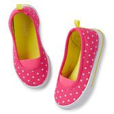 Cute polka dots and contrast colors make these canvas slip-on sneakers extra fun to wear!