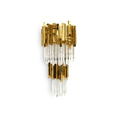 Everything sparkles under this elegant chandelier. This master piece made with gold plated brass combined with ribbed fine tubes of glass brings a natural feeling of waterfalls to any space.