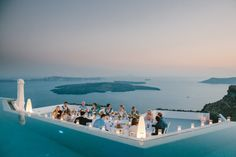 Santorini, Greece  wedding photo shoot inspiration by Theodoros Chliapas. Discover Theodoros' photography on KYMA - find and instantly book your perfect Greece photographer on gokyma.com