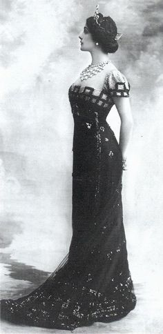 Lina Cavalieri - 1910's - 'The detailing on this elegant black dress perfectly sets off the lavish jewellery worn around the neck.'