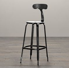 """French T Back Barstool Matte Black     $269         Popularized in 21st-century French factories, our industrial-inspired stool is built of metal from backrest to base. Its ergonomic T-shaped design makes it a functional and enduring addition to any cottage industry.    Show product details...                      Dimensions  Overall: 18""""W x 15""""D x 41""""H  Seat: 29""""H"""
