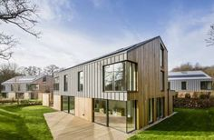 Wooden house near Woburn, Bedfordshire Larch Cladding, House Cladding, Exterior Cladding, House Extension Design, House Design, Cotswold House, Zinc Roof, 1930s House, Wood Architecture
