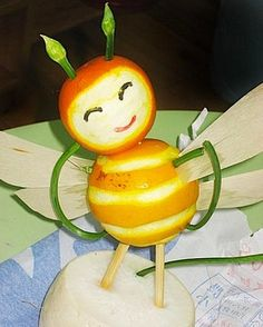 Bee made out of oranges. So cute! #fruitart