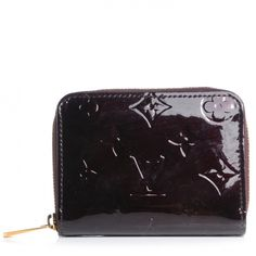 This is an authentic LOUIS VUITTON Vernis Zippy Coin Purse Wallet in Amarante.   This is a fabulous Zippy that is ultrachic and ultrapractical.
