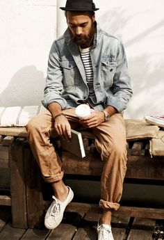 A grey denim jacket and tan chinos feel perfectly suited for weekend activities of all kinds. Grab a pair of white low top sneakers for a more relaxed aesthetic. Shop this look for $110: http://lookastic.com/men/looks/hat-denim-jacket-crew-neck-t-shirt-watch-chinos-low-top-sneakers/7622 — Black Wool Hat — Grey Denim Jacket — White and Navy Horizontal Striped Crew-neck T-shirt — Tan Watch — Khaki Chinos — White Low Top Sneakers