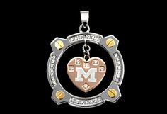 Polished stainless steel circle pendant with swinging pink University of Michigan heart.