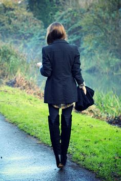 Over the knee boots. Long jacket.