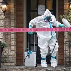 HazMat team disinfects the entrance to the residence of a health worker at the Texas Health Presbyterian Hospital who has contracted Ebola