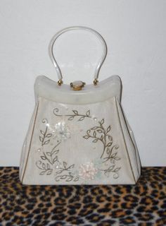 Vintage lucite and plastic purse by Rialto. Large pearl lucite frame and handle, gold metal clasp, embroidered flowers with jewels on fabric all