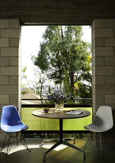 A secondary dining area feels like a balcony when windows are open.