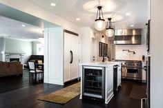 White kitchen, beverage fridge, white subway tiles, oil rubbed bronze hardware