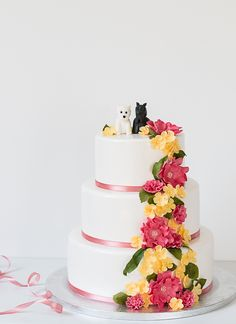 Cake with dog decoration and sugar flowers