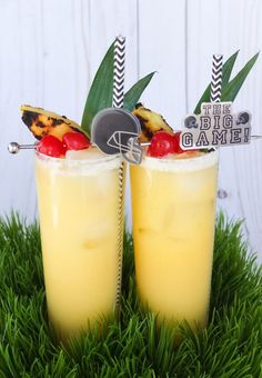 Msg 4 21+. An easy party cocktail for the Big Game! This football cocktail is a mix of flavorful El Yucateco®️️ Green Chile Habanero flavor and a classic tiki drink! Uses pineapple juice, lime juice, dark rum, orange curacao, and cream de coconut! // www.ElleTalk.com #ad #KingofFlavor