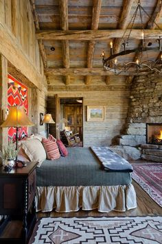 Cozy, beautiful, rustic log cabin bedroom with an amazing  stone fireplace ~ Yummy ~