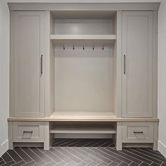 Grey Mudroom Cabinet and herringbone tile. Grey Mudroom Cabinet and herringbone tile. Mudroom Cabinets, Mudroom Laundry Room, Mud Room In Garage, Mud Room Lockers, Mudrooms With Laundry, Closet Mudroom, Mudroom Cubbies, Wood Lockers, Tall Cabinets