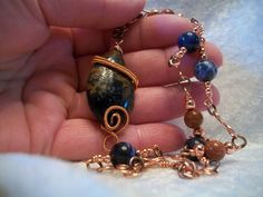 Dark Blue Rust Pietersite Copper Wire Wrapped Pendent Necklace Handcrafted $32.00 $30.00 #TheHareBallJewelry #Pendanthandmade jewelry, unique jewelry, casual wear, shabby chic, boho, bohemian, style, fashion