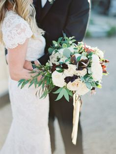 Berry and greenery wedding bouquet: http://www.stylemepretty.com/2016/12/26/winter-wedding-inspo/ Photography: Allen Tsai - http://allentsaiphotography.com/