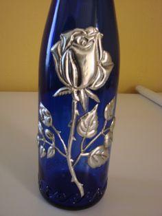 botella de cristal  decorada con estaño