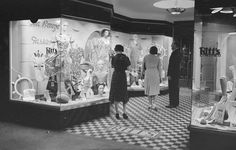 Pedestrians window-shopping at Ritt's Limited, a women's clothing store, at 97 Rideau Street ~ Ottawa, Canada (June 16, 1938)